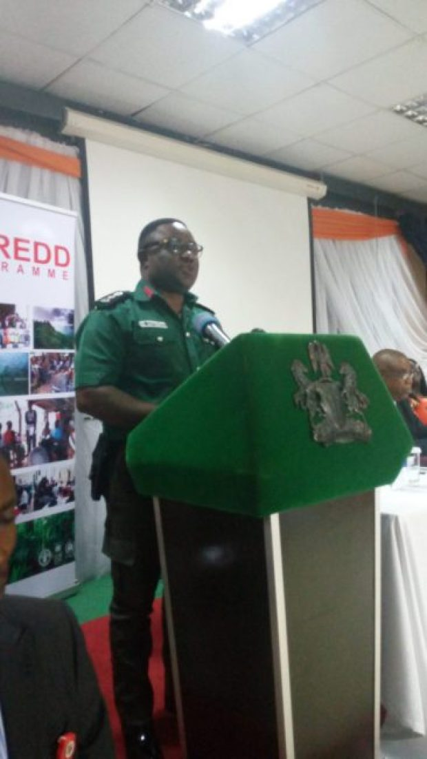 Governor Ben Ayade of Cross River State, dressed as a Green Police, delivering a speech at the Calabar validation exercise
