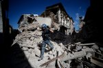 A man walks amid the rubble of buildings in the town of Amatrice on Wednesday after a powerful earthquake rocked central Italy. Photo credit: Filippo Monteforte/Getty  Black Wednesday as quakes hit Italy, Myanmar Italy1 150x100