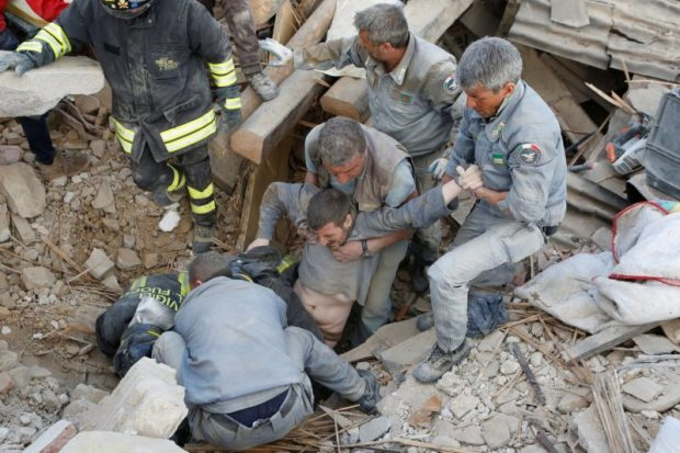 A man is rescued alive from the ruins in Amatrice. Photo credit: Remo Casilli / Reuters  Images: Devastating quake rattles central Italy Italy2 e1472098217857