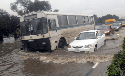 Flood at Ladipo Bus Stop along Lagos Abeokuta Express Road before Oshodi in Lagos, caused by heavy down pour which started on Saturday and rained till Sunday evening in Lagos. Photo credit: Joe Akintola/vanguardngr.com
