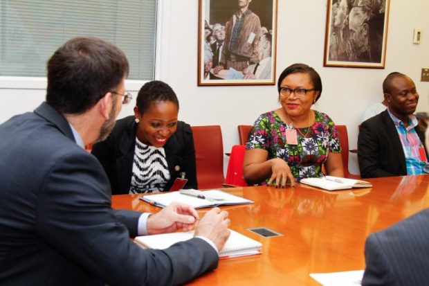 The envoy exchanges pleasantries with Miss Esther Agbarakwe, an aide to the Environment Minister  Images: US climate envoy, Pershing, in Nigeria Envoy7 e1473308706495