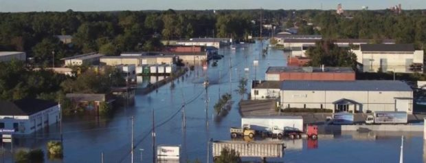 Rivers swollen by Hurricane Matthew have caused widespread flooding in North Carolina, USA