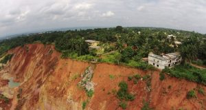 Gully erosion site  Stakeholders seek protection of erosion, flood risk areas in Anambra Anambra e1480376815256