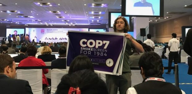 A Students For Liberty activist carries a protest sign at the World Health Organization's Framework Convention on Tobacco Control 7th Annual Conference of the Parties (COP7) in New Delhi, India.