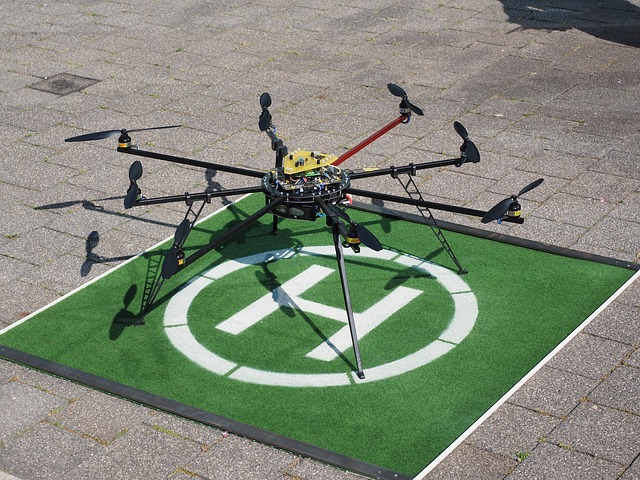 Drone with eight rotors sitting on a landing pad