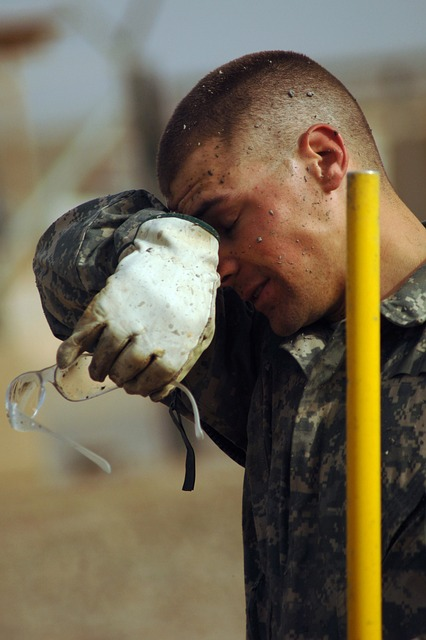 Army soldier wiping his eyes from dirt