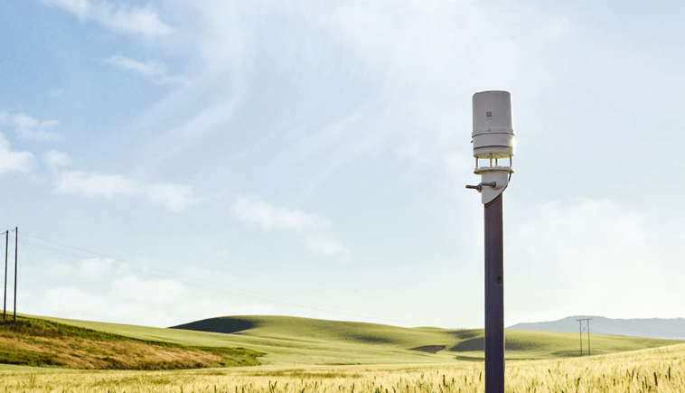 ATMOS 41 weather station standing in a field