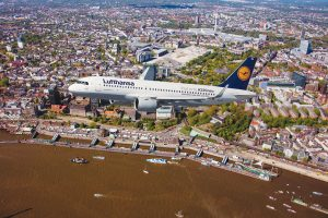Lufthansa is now flying the A320neo, pictured here over the city of Hamburg, in a normal airline schedule, but only to selected destinations. Credit: Lufthansa