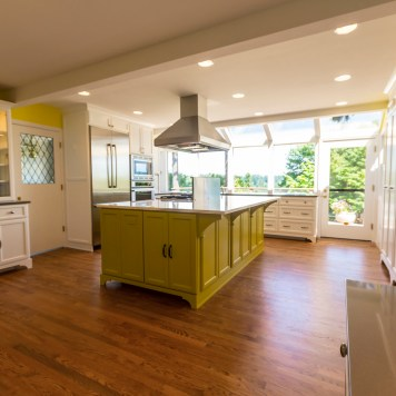 Midcentury kitchen with stained oak hardwood floor
