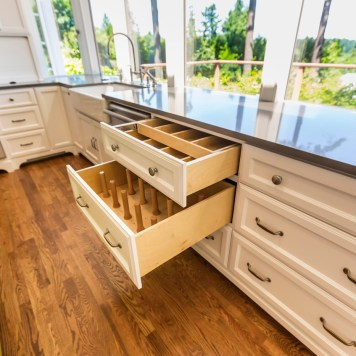 Custom kitchen drawers, stained oak hardwood floors