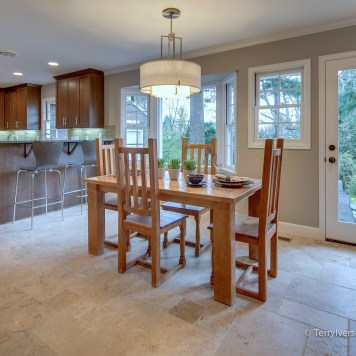Dining room with patterned travertine tile floor