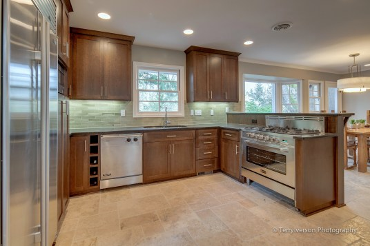 Kitchen with patterned travertine tile floor