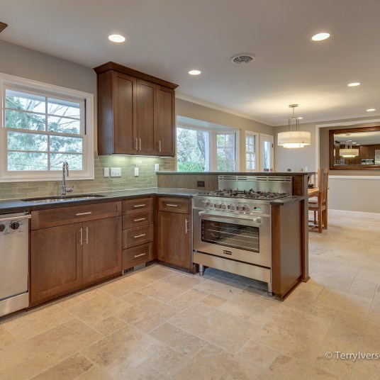 Kitchen and dining room with travertine tile floor