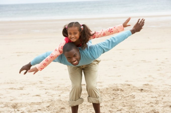 father daughter on beach back ride dads taught enza essentials beautiful