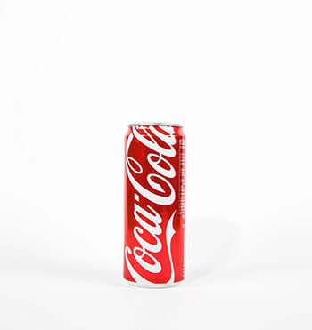 use coca cola to remove oil stains in garage floors