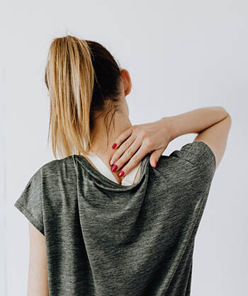 person with touching back