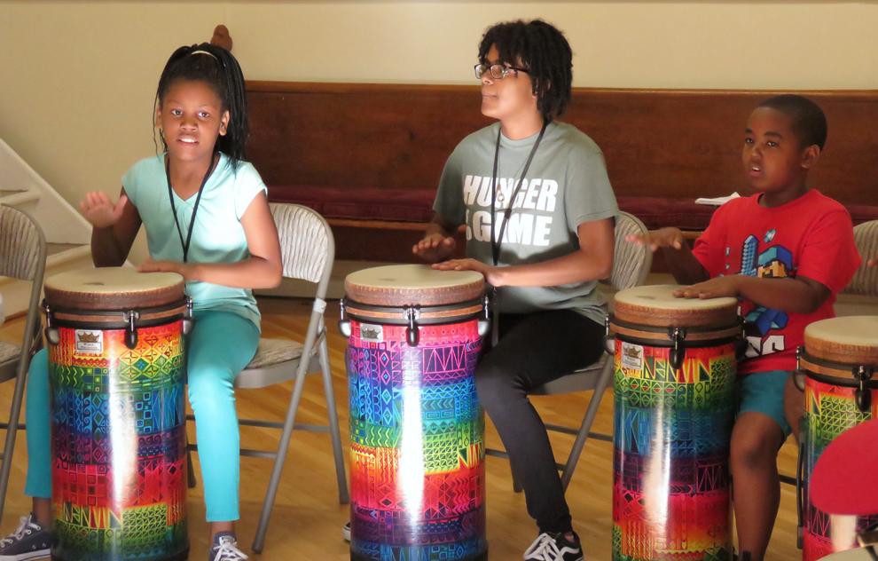 Children drum the rhythms of life at camp