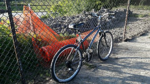 Photo of a bicycle leaning against a fence at Purgatory Creek project