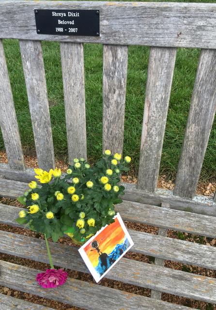 Flowers on Arboretum bench in memory of Shreya Dixit