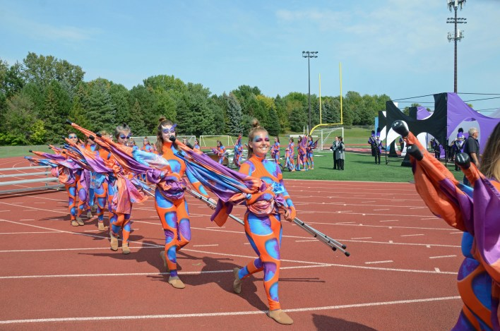 Frontline members of the Grand Rapids marching band leaving the field after performing Sept. 11