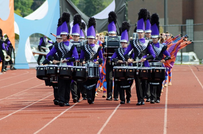 The Grand Rapids marching band paraded in front of the grandstand Sept. 11