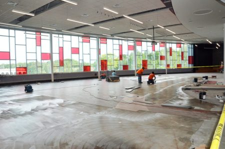Photo of workers installing flooring in the new CMS cafeteria