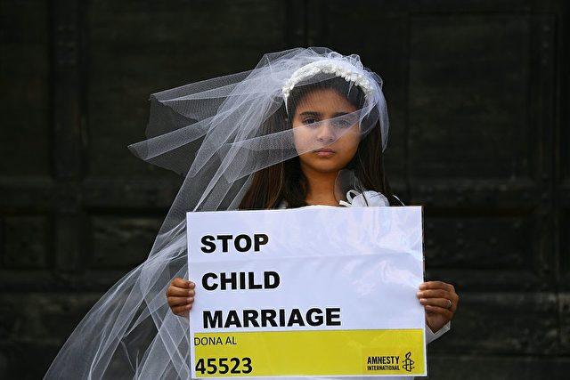 Ein Kind protestiert gegen Kinderehen Foto: GABRIEL BOUYS/AFP/Getty Images