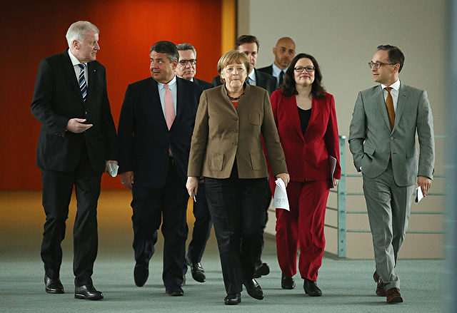 BERLIN, GERMANY - APRIL 14:  (From L to R, first row) Bavarian Governor and head of the Bavarian Christian Democrats (CSU) Horst Seehofer, Vice Chancellor and Economy and Energy Minister and head of the German Social Democrats (SPD) Sigmar Gabriel, German Chancellor and head of the German Christian Democrats (CDU) Angela Merkel, Minister of Work and Social Issues Andrea Nahles and Justice Minister Heiko Maas  arrive to speak to the media following an agreement by the three leaders, whose parties make up the current German coalition government, over new polices on April 14, 2016 in Berlin, Germany. The new policy intitiatives include measures to further the integration of refugees granted asylum status in Germany. Over one million migrants and refugees arrvied in Germany in 2015.  (Photo by Sean Gallup/Getty Images)