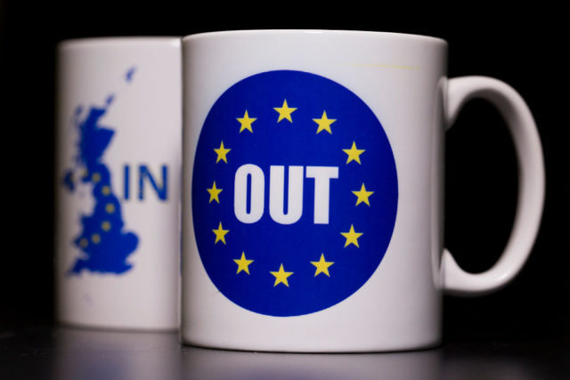 LONDON, UNITED KINGDOM - MARCH 17:  In this photo illustration, the words 'IN' and 'OUT' are depicted on mugs on March 17, 2016 in London, United Kingdom. The United Kingdom will hold a referendum on June 23, 2016 to decide whether or not to remain a member of the European Union (EU), an economic and political partnership involving 28 European countries which allows members to trade together in a single market and free movement across its borders for citizens.  (Photo by Dan Kitwood/Getty Images)