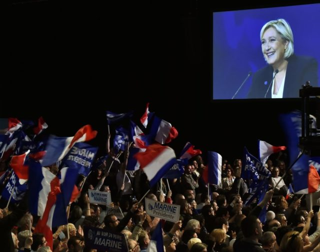 French presidential election candidate for the far-right Front National (FN) party Marine Le Pen is seen on a giant screen as she gives a speech during a campaign meeting on April 2, 2017 at the Bordeaux-Lac exhibition center in Bordeaux, western France.  / AFP PHOTO / GEORGES GOBET        (Photo credit should read GEORGES GOBET/AFP/Getty Images)