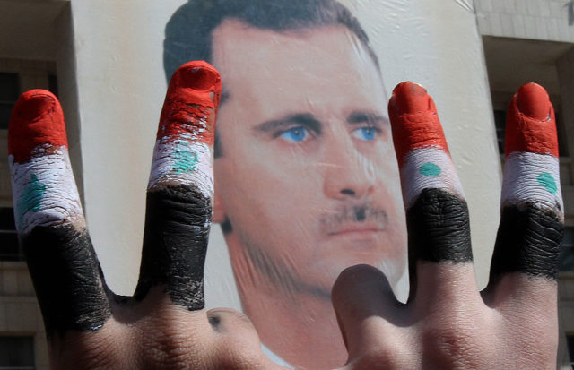 Eine Demonstration zur Unterstützung des syrischen Präsidenten Assad. Foto: ANWAR AMRO/AFP/Getty Images