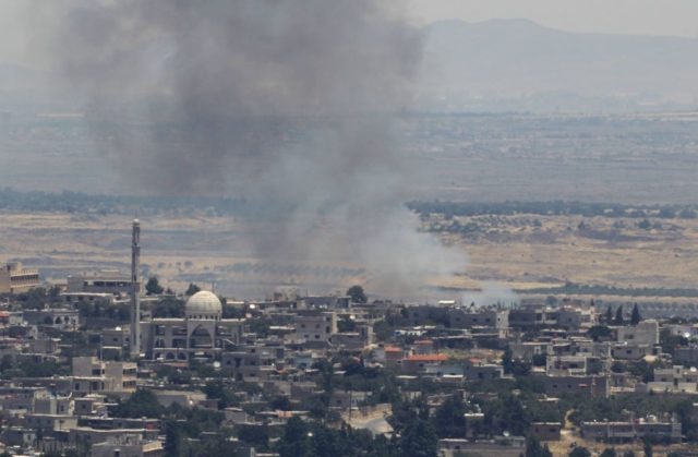 A picture taken from the Israeli-occupied Golan Heights shows smoke billowing from the Syrian side of the border on June 26, 2017. Israeli forces fired on Syria after several projectiles from the war-torn country hit the occupied Golan Heights, the army said, in the second such exchange in three days.  / AFP PHOTO / JALAA MAREY        (Photo credit should read JALAA MAREY/AFP/Getty Images)