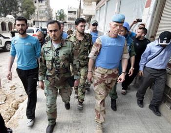 Военные наблюдатели ООН в Сирии. В виду нарушений соглашения о перемирии, ООН удвоит число наблюдателей. Фото:  JOSEPH EID/AFP/GettyImages
