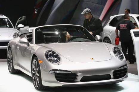 Porsche Cayman на пресс-показе Североамериканского автосалона в Детройте, 15 января 2013 года. Фото: Scott Olson / Getty Images