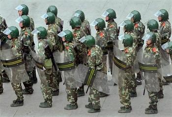 Власти Китая могут использовать борьбу с терроризмом для подавления антиправительственных выступлений. Фото: AFP PHOTO/TEH ENG KOON