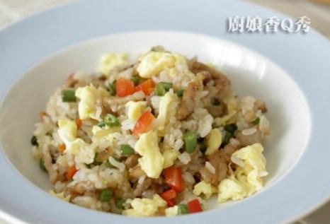 Паровой рис с китайским рагу. Фото: NTDTV