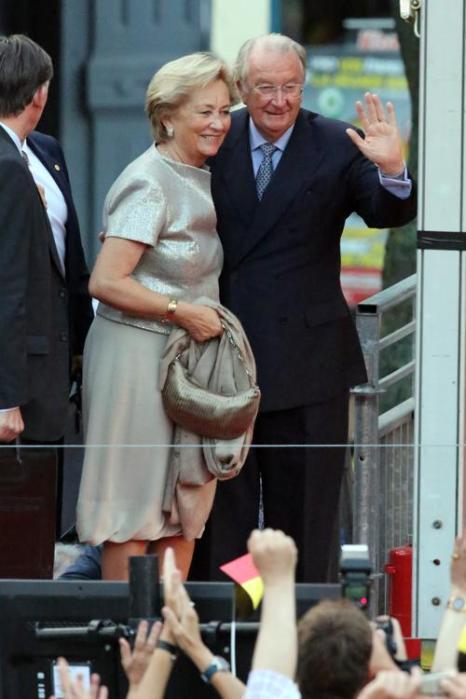 Королева Паола и Король Бельгии Альберт II прибыли на праздник в честь отречения и коронации в Брюсселе (Бельгия) 20 июля 2013 года. Фото: Mark Renders/Getty Images