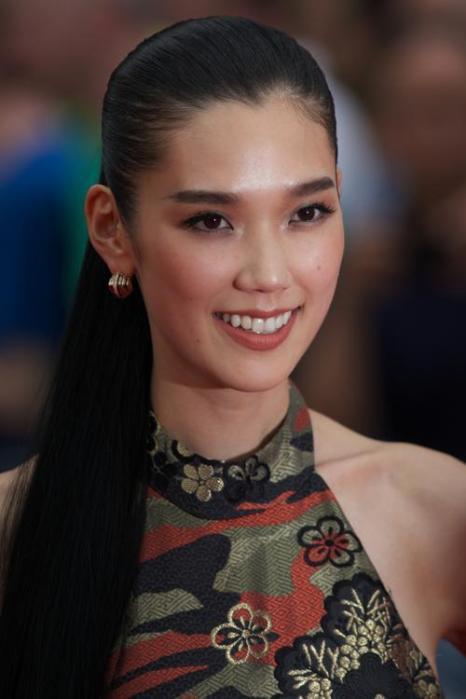 Японская модель и актриса Дао Окамото. Модные причёски июля продемонстрировали знаменитости на ярких мероприятиях июля 2013 года. Фото: ANDREW COWIE/AFP/Getty Images