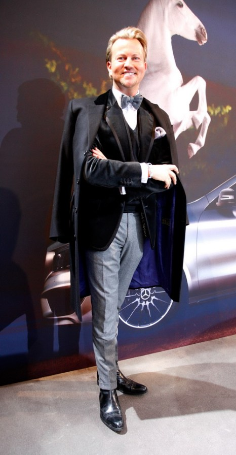 Сандро Рат (Sandro Rath) в брюках, куртке и пальто от Thomas Rath на Mercedes-Benz Fashion в Берлине, 18 января 2013 года. Фото: Anke Grelik/Getty Images