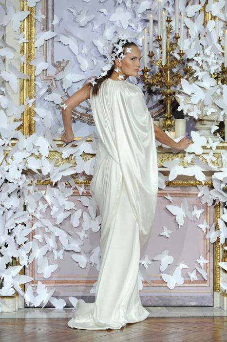 Известный французский дизайнер Алексис Мабилле представил романтическую коллекцию свадебных платьев Alexis Mabille 2014 года на Неделе высокой моды в Париже 20 января. Фото: Pascal Le Segretain / Getty Images