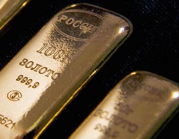 Золотые слитки. Фото РИА Новости