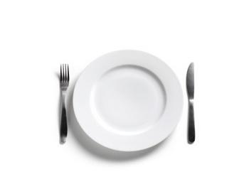 Попробуйте есть дважды в день, пропуская обед. Фото: Peter Dazeley/Getty Images