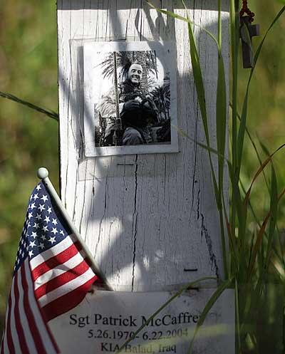 Фотография солдата, который был убит в Ираке. Фото: Justin Sullivan/ Getty Images
