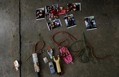 Лагерь «Красных рубашек» сдался властям Таиланда. Фоторепортаж. Фото: MANAN VATSYAYANA/AFP/Getty Images