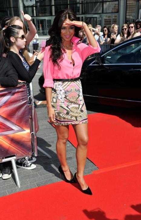 Певица Николь Шерзингер прибыла на прослушивания шоу талантов «X-фактор» в Лондоне 15 июля 2013 года. Фото: Gareth Cattermole/Getty Images
