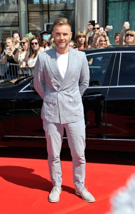Певец Гэри Барлоу прибыл на прослушивания шоу талантов «X-фактор» в Лондоне 15 июля 2013 года. Фото: Gareth Cattermole/Getty Images