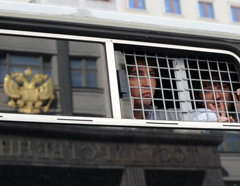 Задержанные сторонники оппозиции. Фото:  NATALIA KOLESNIKOVA/AFP/GettyImages