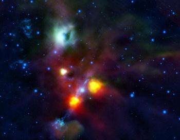 Туманность NGC 1999 показана бирюзовым цветом. Космическая пустошь – это черное пятно в правой части туманности. Фото с сайта esa.int