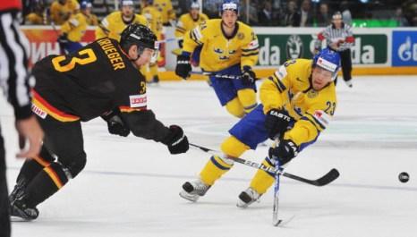 Швеция – Германия. Фото: Lars BARON, Martin ROSE, Joe KLAMAR, Juergen SCHWARZ, Alexander NEMENOV/Bongarts/Getty Images