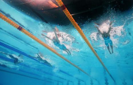 Юлия Ефимова вышла в финал в плавании брасом на 100 метров в 10-й день Чемпионата мира по водным видам спорта 29 июля 2013 года в испанской Басрелоне. Фото: Adam Pretty/Getty Images